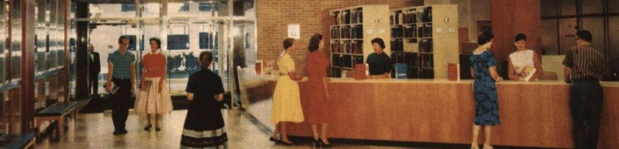 A photo of the old Assumption University Library, with multiple people interacting at the circulation desk.