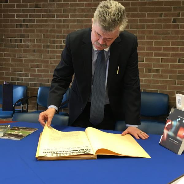 Dr. Kurnicki examines the Leddy Library's Polonia collection